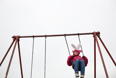 Jenny Kane - jkane@shawmedia.com Madysen Lockinger, 7, of Woodstock swings on the swings set at Emricson Park in Woodstock before the Woodstock Jaycees's annual Easter Egg Hunt on Saturday.