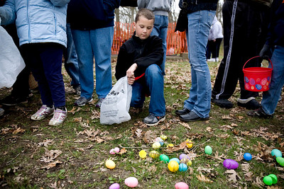 Jenny Kane - jkane@shawmedia.com Kyle Zang, 10, of Woodstock, waits patiently until he and the rest of the 7-10 year olds are allowed to collect eggs during the Woodstock Jaycees's annual Easter Egg Hunt at the Hilltop Pavilion at Emricson Park in Woodstock on Saturday. It was Zang's last year to collect eggs.