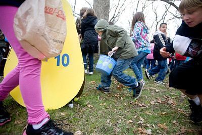 Jenny Kane - jkane@shawmedia.com A group of 7 to 10-year-olds rush the easter egg hung area during Woodstock Jaycees's annual Easter Egg Hunt at the Hilltop Pavilion at Emricson Park in Woodstock on Saturday.