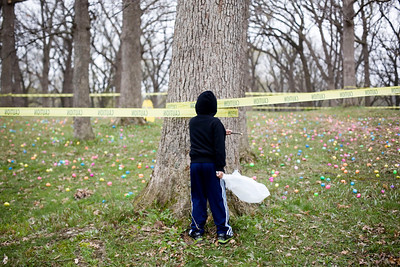 Jenny Kane - jkane@shawmedia.com A child sword fights using a stick with a tree while waiting for the Woodstock Jaycees's annual Easter Egg Hunt to begin at the Hilltop Pavilion at Emricson Park in Woodstock on Saturday.