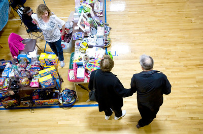 Jenny Kane - jkane@shawmedia.com Joyce and Marty Miller, of Huntley, look at Debbie Madej's table during the 4th Annual McHenry County Garage & Indoor Sidewalk Sale. The sale was held at the Park District REC Center in Huntley. There were five sponsors and 55 venders. Set up for the sale started at 6 a.m. and the sale ran from 8 a.m. to 2 p.m. on Saturday.