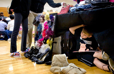 Jenny Kane - jkane@shawmedia.com Andrew Hettermann, 8, of McHenry, peaks out from under a table at his mother Tammie Hettermann's booth during the 4th Annual McHenry County Garage & Indoor Sidewalk Sale. The sale was held at the Park District REC Center in Huntley. There were five sponsors and 55 venders. Set up for the sale started at 6 a.m. and the sale ran from 8 a.m. to 2 p.m. on Saturday.