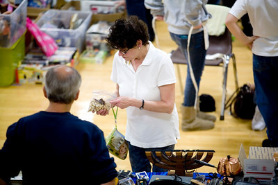 Jenny Kane - jkane@shawmedia.com Linda McCray buys a religious pin from Hart Klotz for 50 cents during the 4th Annual McHenry County Garage & Indoor Sidewalk Sale. The sale was held at the Park District REC Center in Huntley. There were five sponsors and 55 venders. Set up for the sale started at 6 a.m. and the sale ran from 8 a.m. to 2 p.m. on Saturday.