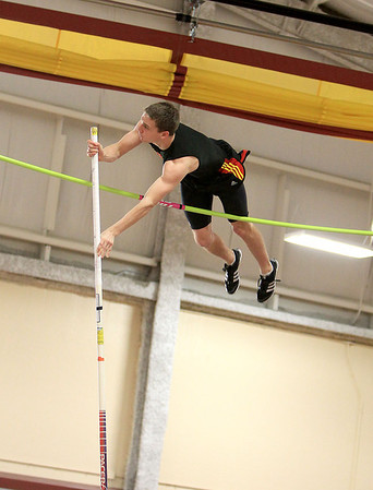 Sandy Bressner - sbressner@shawmedia.com<br /> Bennett Hartmann of Batavia competes in the pole vault during the 2012 Upstate Eight Conference Boys Indoor Track and Field Championships at Batavia High School Friday.