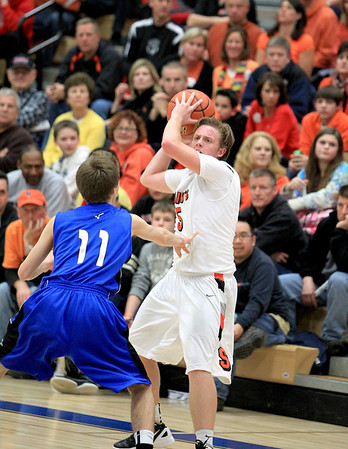 Sandy Bressner - sbressner@shawmedia.com<br /> St. Charles East's Dom Urso looks for a teammate to pass the ball to over St. Charles North's Alec Goetz during their regional game at North Wednesday night.