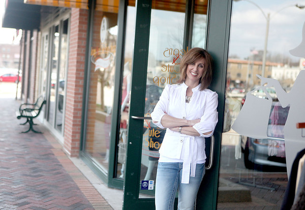 Sandy Bressner - sbressner@shawmedia.com<br /> Jill Card, owner of Jeans and a Cute Top Shop on First Street in St. Charles, is part of the Downtown St. Charles Partnership, which is celebrating 20 years this year.