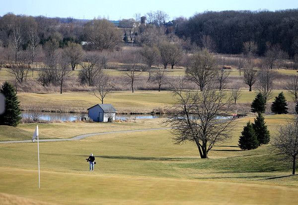 Sandy Bressner - sbressner@shawmedia.com<br /> Marc Burkes of St. Charles walks to the ninth holeTuesday afternoon at Hughes Creek Golf Club in Elburn.