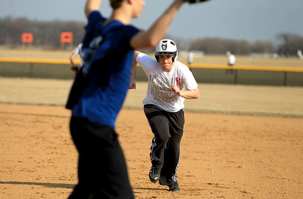 Sandy Bressner - sbressner@shawmedia.com<br /> Kaneland's Blake Sowell runs back to firrst base during practice Wednesday afternoon.