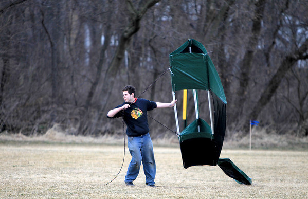 Sandy Bressner - sbressner@shawmedia.com<br /> Rob Schulman of Geneva attempts to get a kite in the air at Wheeler Park in Geneva Wednesday afternoon. Schulman and his friends Dane Honeyman and Stephen Gibson, both of Geneva, (not pictured) made the kite using a tarp and PVC pipe.