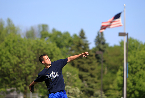 Geneva thrower Kyle McNeil, who won the UEC River titles in the shot put and discus, throws the discus during practice Wednesday. McNeil is eyeing more success at Friday's 3A St. Charles North Sectional