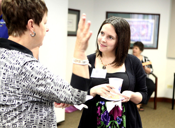 Hallie Hudson of Tri-City Family Services talks with Judy Burgess of St. Charles, founder of the Friends of Tri-City Family Services and longtime volunteer with the organization, during a multi-chamber business after-hours mixer at their Geneva facility Thursday afternoon.