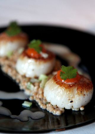 Sandy Bressner - sbressner@shawmedia.com<br /> Seared bay scallops with carrot honey puree and toasted Israeli cous cous by Chef Serena Teipel Perdue at Niche Restaurant in Geneva.