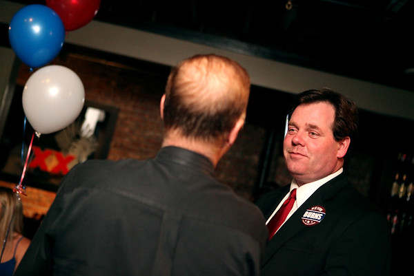 Sandy Bressner - sbressner@shawmedia.com<br /> Kane County Chairman candidate Kevin Burns (right) talks with Mark Spero as election results come in Tuesday at Old Towne Pub in Geneva.