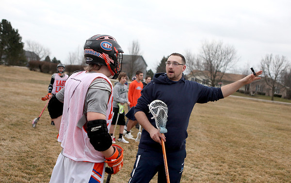 Sandy Bressner - sbressner@shawmedia.com<br /> St. Charles East lacrosse co-coach Aaron Vermedal talks with player Chad Williams during practice at Cranston Meadows Park in St. Charles Wednesday afternoon.