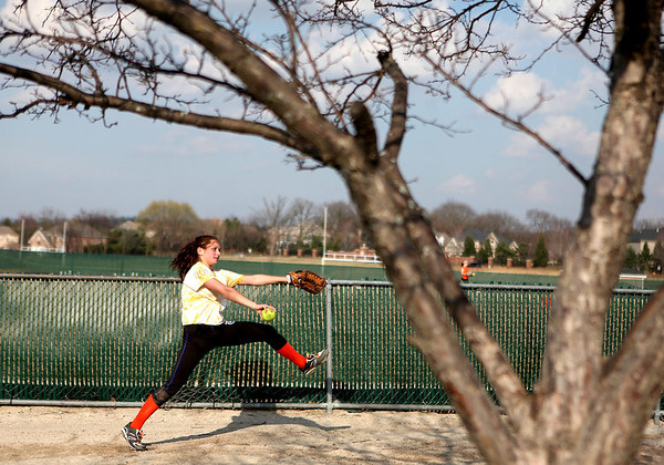 Sandy Bressner - sbressner@shawmedia.com<br /> St. Charles East's Leah Valesh pitches during practice at the school Thursday afternoon.