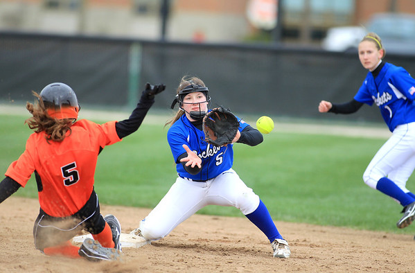 Sandy Bressner - sbressner@shawmedia.com<br /> Bekah Harnish of Burlington Central fails to get St. Charles East's Lexi Perez out at second during their game at East Monday morning. St. Charles East won the game 8-7.