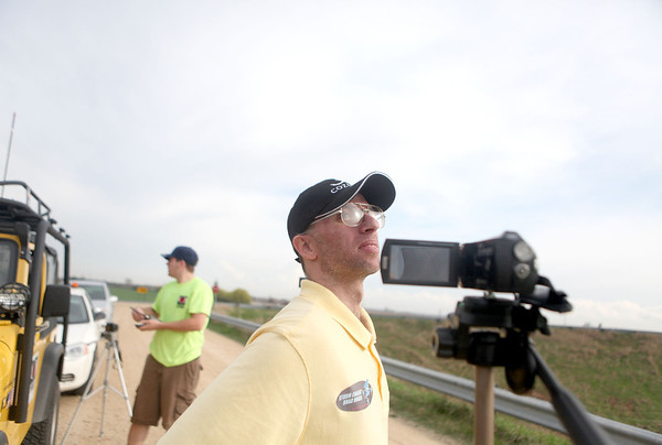 Sandy Bressner - sbressner@shawmedia.com<br /> Storm chaser Brad Hruza looks to the sky during a storm watch off of Keslinger Road at Interstate 88 near DeKalb County.