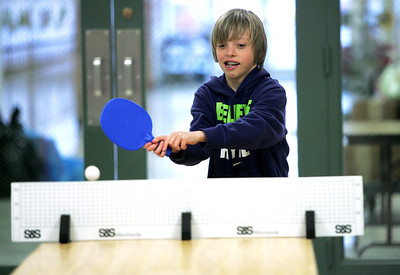 Monica Maschak - mmaschak@shawmedia.com Gabriel McNally, 9, a fourth grader at Riverwood Elementary, swings for the ping pong ball at the Preteen Jam hosted by the McHenry Parks and Recreation Department at Duker School on Friday, March 1, 2013. Fourth and fifth graders from District 15 schools were all invited to participate in dancing, games, door prizes and more.