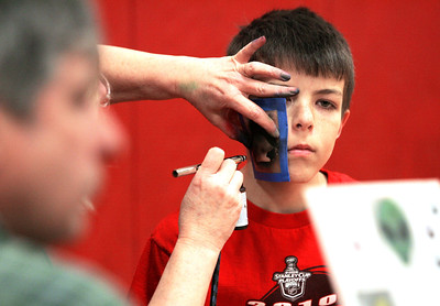 Monica Maschak - mmaschak@shawmedia.com Cole Payton, 10, a fourth grader at Duker School has a penquin airbrushed onto his face during the Preteen Jam hosted by the McHenry Parks and Recreation Department at Duker School on Friday, March 1, 2013. Fourth and fifth graders from District 15 schools were all invited to participate in dancing, games, door prizes and more.