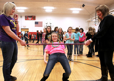 Monica Maschak - mmaschak@shawmedia.com Abby Jones, 9, a fourth grader at Riverwood, dips under the limbo bar at the Preteen Jam hosted by the McHenry Parks and Recreation Department at Duker School on Friday, March 1, 2013. Fourth and fifth graders from District 15 schools were all invited to participate in dancing, games, door prizes and more.