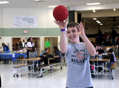 Monica Maschak - mmaschak@shawmedia.com Sam Baser, 10, shoots a ball into a hoop as one of the carnival games at the 17th annual Silent Auction and Family Fun Fair Glacier Ridge Elementary School on Saturday, March 2, 2013. The fundraiser offered a silent auction, carnival games, book and cake walks, food, a bonus raffle, theme baskets, wine and dine packages, and more to benefit the Carl Wehde Early Childhood Special Education Center.