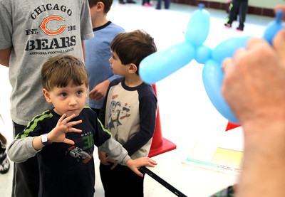 Monica Maschak - mmaschak@shawmedia.com Braden Braun, 4, anxiously awaits the making of his balloon animal during the 17th annual Silent Auction and Family Fun Fair Glacier Ridge Elementary School on Saturday, March 2, 2013. The fundraiser offered a silent auction, carnival games, book and cake walks, food, a bonus raffle, theme baskets, wine and dine packages, and more to benefit the Carl Wehde Early Childhood Special Education Center.
