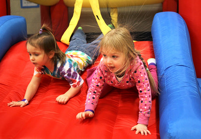 Monica Maschak - mmaschak@shawmedia.com Claire Brock (left), 3, and Karissa Whitehead, 3, emerge from a bouncy house with static hair during the 17th annual Silent Auction and Family Fun Fair Glacier Ridge Elementary School on Saturday, March 2, 2013. The fundraiser offered a silent auction, carnival games, book and cake walks, food, a bonus raffle, theme baskets, wine and dine packages, and more to benefit the Carl Wehde Early Childhood Special Education Center.