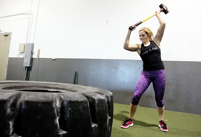 Sarah Nader - snader@shawmedia.com Paige Roeser, 17, of Crystal Lake trains at Davis Speed Center in Crystal Lake on Wednesday, March 13, 2013. Roeser placed 12th in the Arnold Strongman competition recently.