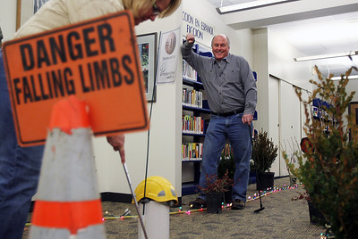 Sarah Nader - snader@shawmedia.com Tom Nierman (right) of Woodstock watched Denise Graff Ponstein of Woodstock putt while attending Mini Links Library After Dark at the Woodstock Public Library on Friday, March 15, 2013. Transformed by the Friends of Woodstock Public Library the library featured an 18-hole miniature golf course that covered all three levels of the library. The event continues on Saturday from 10 a.m. to 3 .p.m. for families and children.
