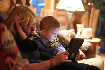 Sarah Nader - snader@shawmedia.com Jill Berg reads to her son, Joe, 3, at their home in McHenry on Monday, March 18, 2013. Berg adopted her son in December after waiting for more than two years.