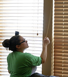 H. Rick Bamman - hbamman@shawmedia.com The Cleaning Authority crew member Jessica Martinez of Lake in the Hills prepares to clean the shades in the Elgin home of Gina O'Connor.  Cary based The Cleaning Authority has joined up with a national campaign - Cleaning for a Reason to clean the homes of women battling cancer for free on a monthly basis.