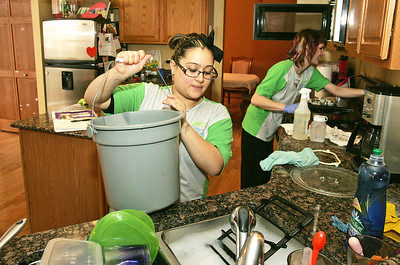 H. Rick Bamman - hbamman@shawmedia.com The Cleaning Authority crew members Jessica Martinez of Lake in the Hills and Annie Rolewski of McHenry work in the Elgin home of Gina O'Connor.