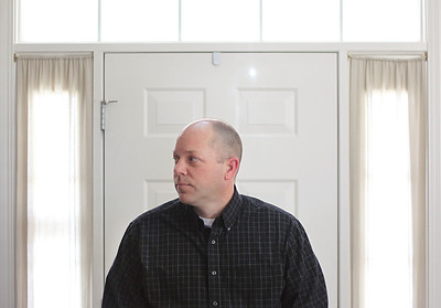 Sarah Nader - snader@shawmedia.com Kurt Johnson of Volo poses for a portrait in his home on Wednesday, March 20, 2013. Johnson is Volo's newest trustee, he will serve the remainder of outgoing Trustee Kurt Justice's seat until the April 2015 election.