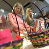 """Jeff Krage – For Shaw Media<br /> Liz Lucas, center, of Batavia helps make an Easter basket for local charity """"I Believe, too"""" with her grandchildren Austin and Alli Hoehl, 12 and 14, of North Aurora during Saturday's event at the Batavia Moose Lodge.<br /> Batavia 3/23/13"""