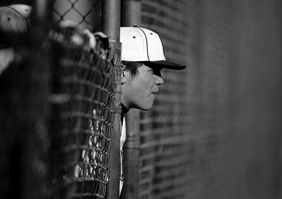 Sarah Nader - snader@shawmedia.com A Prairie Ridge baseball watches his teammates during Tuesday's game at Lippold Park in Crystal Lake on March 26, 2013. Prairie Ridge won, 9-1.