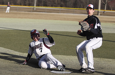 Sarah Nader - snader@shawmedia.com Prairie Ridge's Matt Furst slides safely into home base during Tuesday's game against Harlem at Lippold Park in Crystal Lake on March 26, 2013. Prairie Ridge won, 9-1.