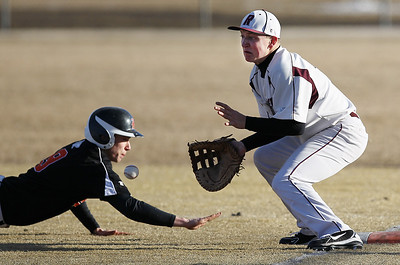 Sarah Nader - snader@shawmedia.com Prairie Ridge's Matt Furst waits for the pass while Harlem's Josh Dickerson safely slides back to first during Tuesday's game at Lippold Park in Crystal Lake on March 26, 2013. Prairie Ridge won, 9-1.