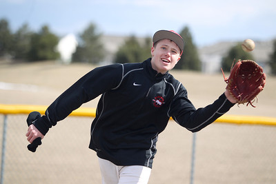 Sarah Nader - snader@shawmedia.com Huntley Mason Martin plays catch with a teammate at baseball practice in Huntley on Tuesday, March 26, 2013. The baseball team decided that Martin will pitch at their opening-day game on Wednesday in DeKalb.