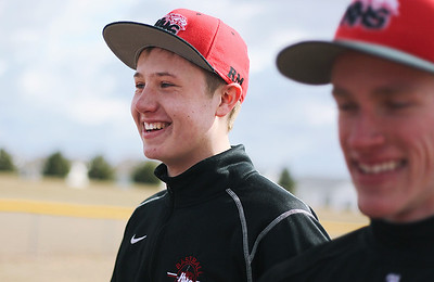 Sarah Nader - snader@shawmedia.com Huntley Mason Martin (left) listens to his coach while at baseball practice in Huntley on Tuesday, March 26, 2013. The baseball team decided that Martin will pitch at their opening-day game on Wednesday in DeKalb.
