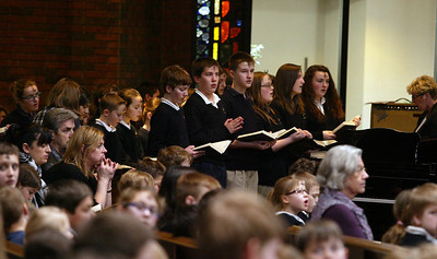 H. Rick Bamman - hbamman@shawmedia.com The St. Thomas the Apostle Catholic School choir per forms during the Ash Wednesday Mass.