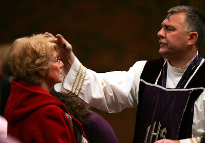 H. Rick Bamman - hbamman@shawmedia.com Pat Dumas (left) of Huntley receives an ash cross on her forehead from Fr. Jerome Koutnik at St. Thomas the Apostle Catholic Church in Crystal Lake. Wednesday marked the begining of Lent and the 40 days of fasting leading up to Easter.