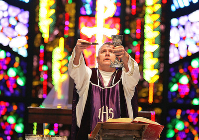 H. Rick Bamman - hbamman@shawmedia.com Fr. Jerome Koutnik celebrates Ash Wednesday Mass at St. Thomas the Apostle Catholic Church in Crystal Lake. Wednesday marked the begining of Lent and the 40 days of fasting leading up to Easter.