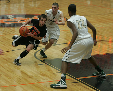 Monica Maschak - mmaschak@shawmedia.com Brad Knoeppel speeds into the zone during the last half of the second round in the IHSA 4A Boys Sectional against Boylan at DeKalb High School on Thursday, March 7, 2013. The Tigers lost to the Titans  60-49.