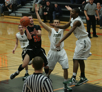 Monica Maschak - mmaschak@shawmedia.com Brad Knoeppel leaps for the basket in the final quarter of the IHSA 4A Boys Sectional against Boylan at DeKalb High School on Thursday, March 7, 2013. The Tigers lost to the Titans  60-49.