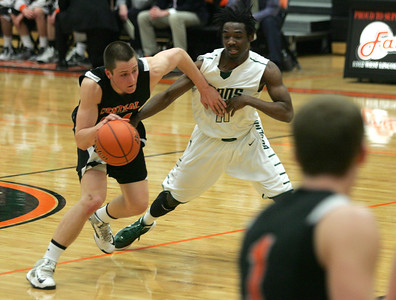 Monica Maschak - mmaschak@shawmedia.com Jake Vanscoyoc gets slowed down by an opponent in the second round of the IHSA 4A Boys Sectional against Boylan at DeKalb High School on Thursday, March 7, 2013. The Tigers lost to the Titans  60-49.