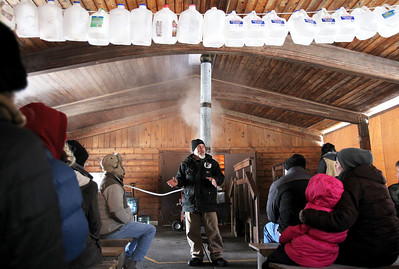 Monica Maschak - mmaschak@shawmedia.com Volunteer Andy Talley speaks to attendees in the final stop of the Festival of the Sugar Maples about the last process of turning sap into syrup at Coral Woods Conservation Area on Saturday, March 2, 2013.