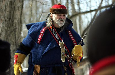 Monica Maschak - mmaschak@shawmedia.com MCCD Volunteer Jerry Martin tells a Native American tale of how maple syrup was discovered at the Festival of the Sugar Maples at Coral Woods Conservation Area on Saturday, March 2, 2013.