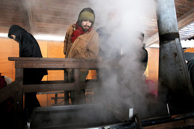 Monica Maschak - mmaschak@shawmedia.com Aaron Findley, 22, peaks into the evaporator where sap is turned into syrup during the Festival of the Sugar Maples at Coral Woods Conservation Area.