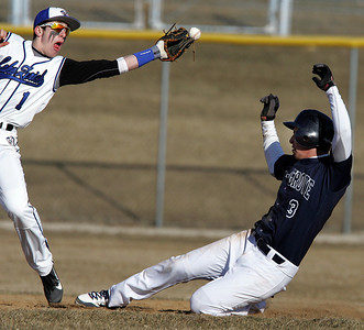 H. Rick Bamman - hbamman@shawmedia.com Cary Grove's Daniel Vilardo slides safely into second as Lake Zurich's  Joey Holtz misses the throw in the second inning. Cary-Grove won 13-10.