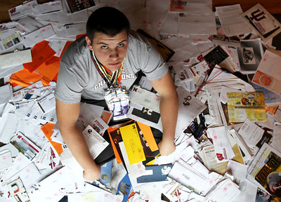 Monica Maschak - mmaschak@shawmedia.com Shane Evans, a junior offensive lineman at Prarie Ridge, is perhaps our area's most sought after high school recruit. Here, he is surrounded by hundreds of letters from about 40 different schools showing interest.
